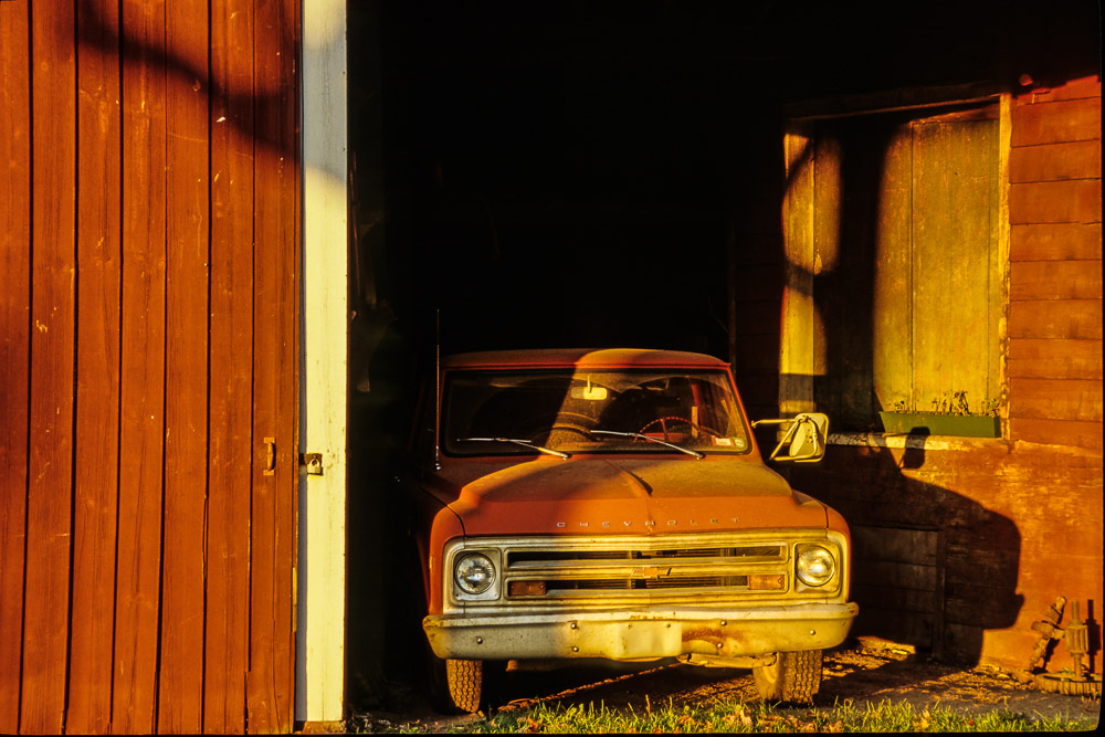 red truck in red barn